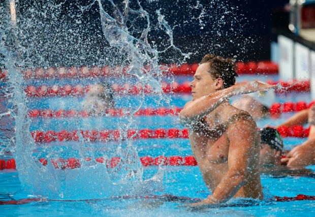 Brazil's Filho Cesar Cielo splashes the water after winning the gold medal in the Men's 50m butterfly final at the FINA Swimming World Championships in Barcelona, Spain, Monday, July 29, 2013. (AP Photo/Emilio Morenatti)
